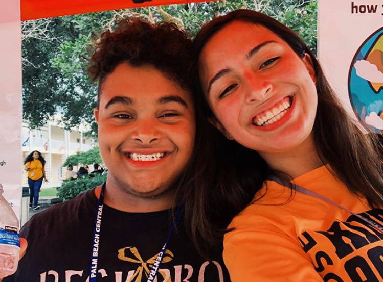 Zain+Savage+and+Ida+Alvarado%2C+pictured+respectively%2C+are+all+smiles+at+last+year%27s+anti-bullying+day+working+the+Best+Buddies%27+booth.+Zain%2C+Ida%2C+and+many+other+%27buddies%27+gather+signatures+to+stop+bullying+every+year+in+honor+of+this+day