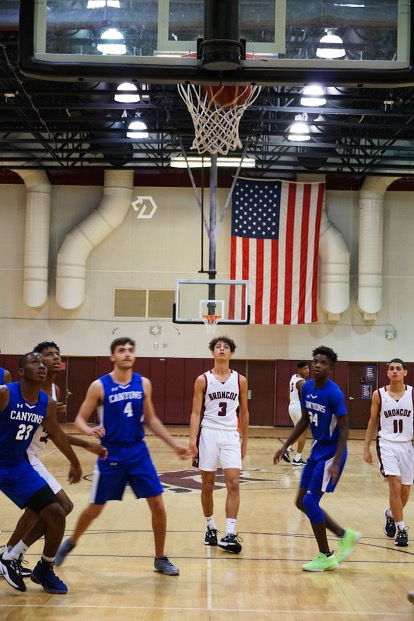 Max+Cedeno+and+teammate+Eduardo+Diaz+play+against+the+Canyons+on+their+home+court.+Like+many+of+the+school%27s+athletes%2C+they+can+balance+both+academics+and+sports+in+their+schedules.