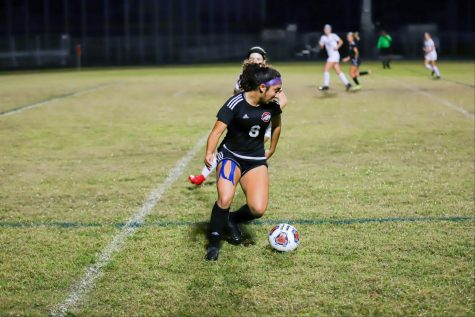 Bronco soccer player Leila Etemadi holds down the fort during a varsity game. Many athletes choose not to go pro after college but rather choose a field that is still relative to sports like medicine or  marketing.