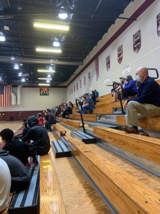 Social+distancing+on+bleachers%2C+mandatory+masks%2C+and+temperature+checks+are+just+some+of+the+restrictions+put+into+place+to+keep+both+fans+and+players+safe.