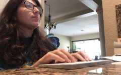 Sarah Garfield works diligently to review submissions sent in by students for Central's literary magazine, The Palm Beach Central Review.