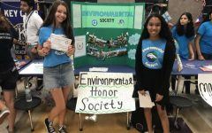 Abby Sherry and Kaira Yee manned the Environmental Honor Society table during club rush last year.  Groups like EHS help bring awareness to students about the environment and their future.
