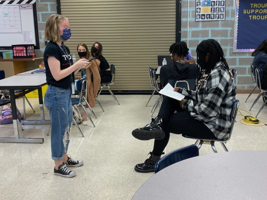 Senior Jadyn Yokie (left) and sophomore Moriah King (right) perform a practice scene. This read-through is one of the many activities theater students do to prepare for upcoming musicals.