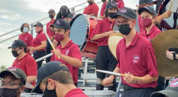 The Bronco Band Percussion section plays a cadence during a football game. To make up for lost practice during the pandemic, the band is now playing at every game, both home and away.