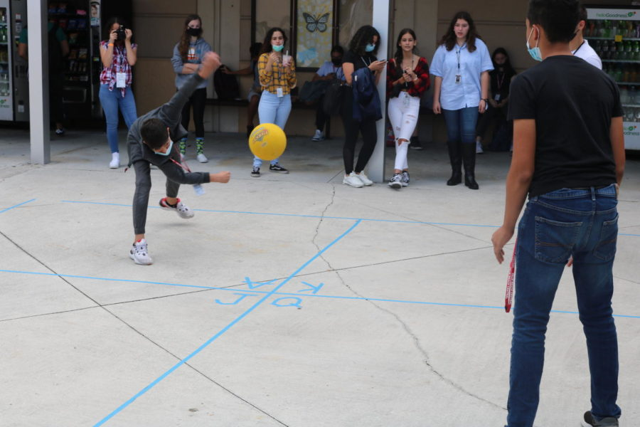 Students square off in the courtyard to play a friendly game of Four Square.