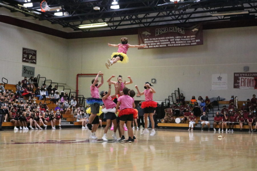 After many practices, the junior Powderpuff cheerleaders performed a basket toss the wowed the seniors in attendance.