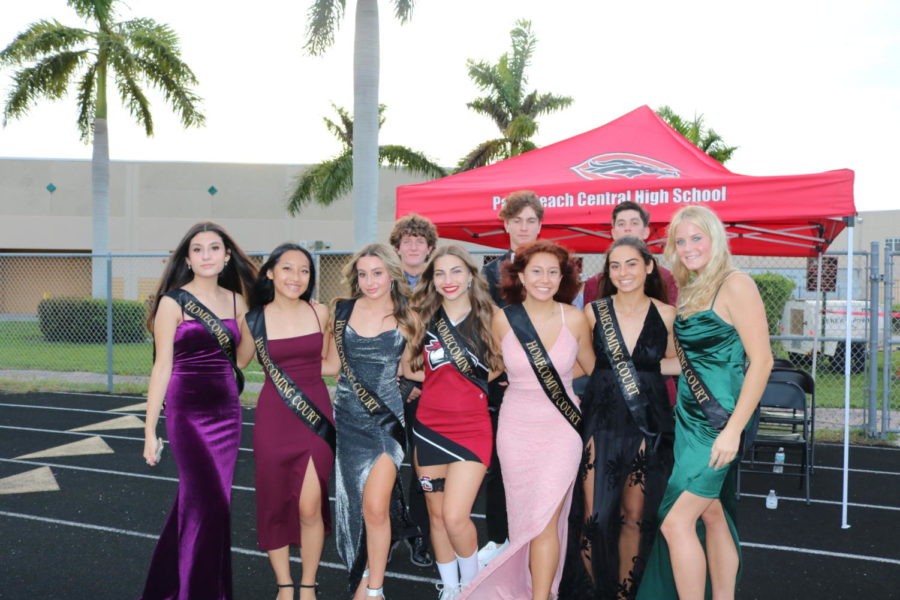 Homecoming court representatives (left to right, bottom row) Analisa Balla, Michelle Qi, Cameron Byck, Caleigh Grayson, Dailany Echeverria, Kaiah Hoffman, Madison Dalman, (left to right, top row) James Agugliaro, Brody Gullo, and Ryan Rundle await the announcement of Homecoming King and Queen at halftime.
